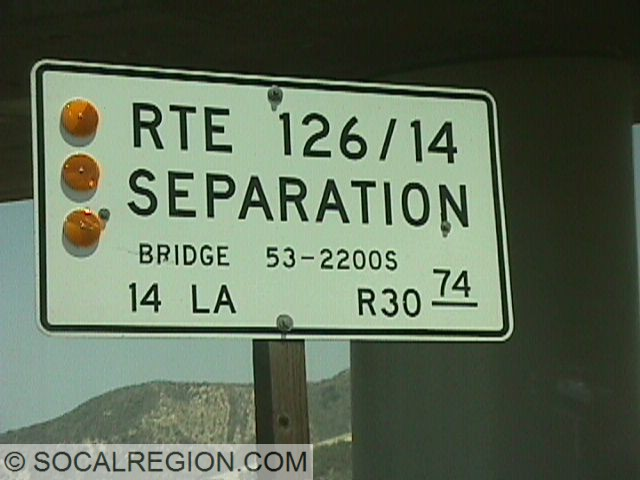 Former bridge sign with State 126 showing.