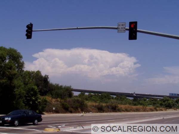 Thunderstorm above Julian from Mission Valley. I-805 overcrossing is in the background.