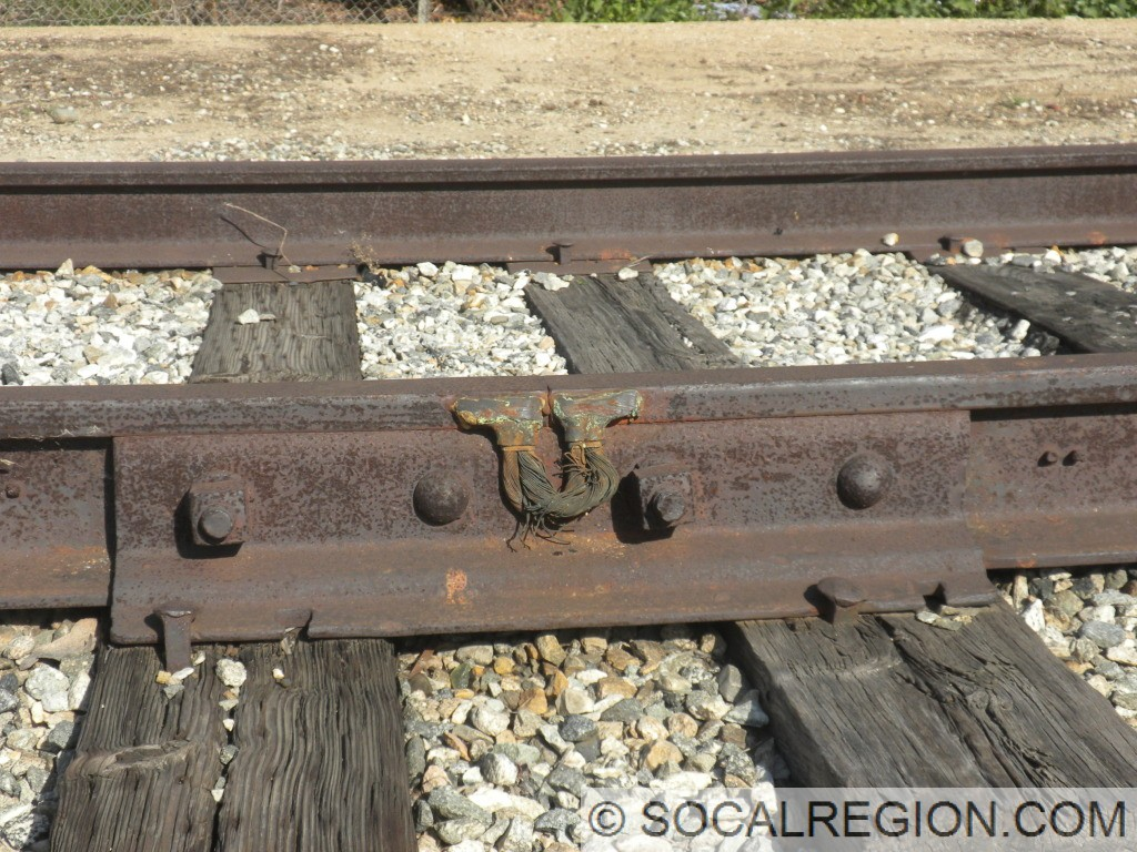 Rail bonding. Rails are from the 1920's.
