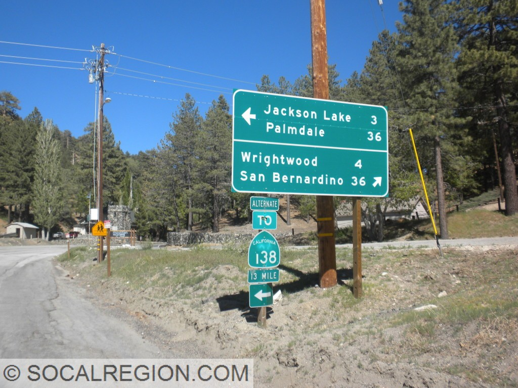 Signage at the junction with Big Pines Highway and a rare Alternate sign.