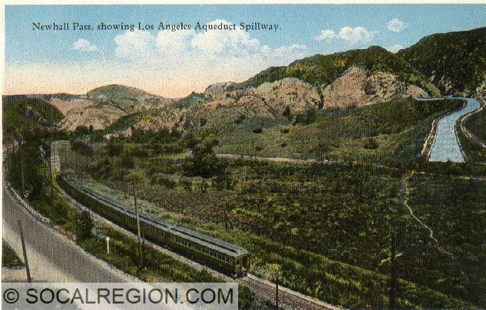 Postcard from the 1920's showing the Los Angeles Aqueduct and US 99. This is just west of the present Balboa Blvd OC.