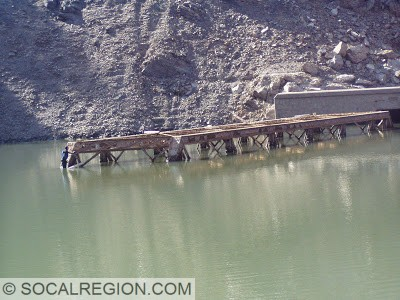 Swimming to a 1901 Southern Pacific Railroad bridge and tunnel in Lake Shasta near Lakehead. October 2008.
