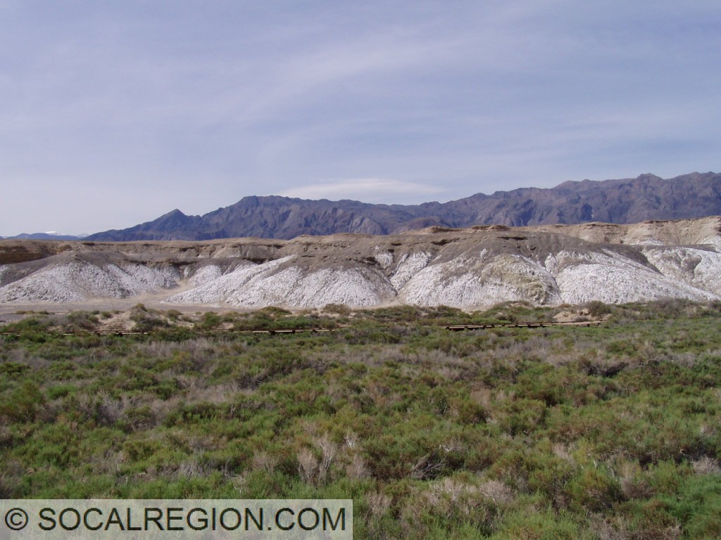 Former lake bed deposits uplifted and eroded, creating broad canyon that Salt Creek flows through.