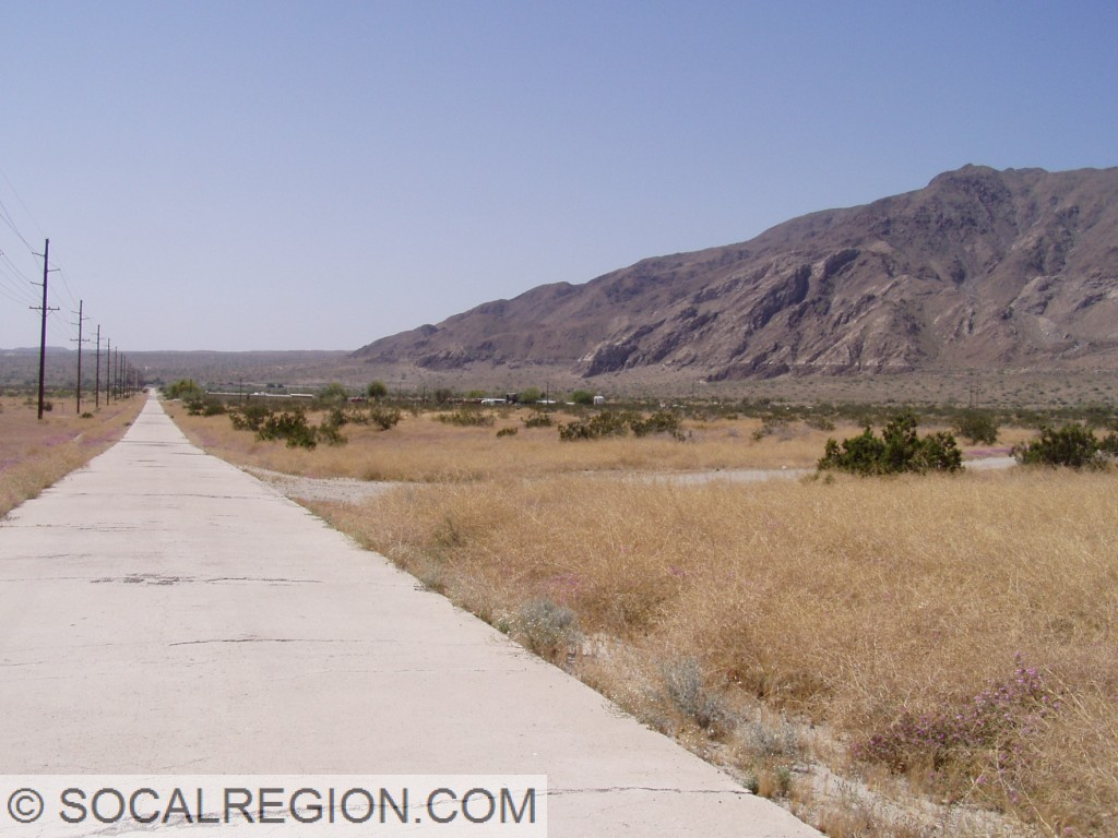 Old US 99 near Coolidge Springs, Imperial County, CA with the shoreline of Lake Cahuilla visible in the background.