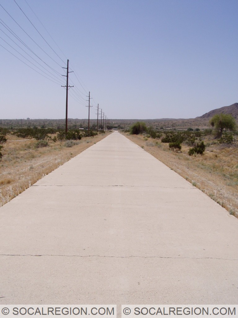 Original paving with faded striping near Coolidge Springs at the Imperial / Riverside County Line.