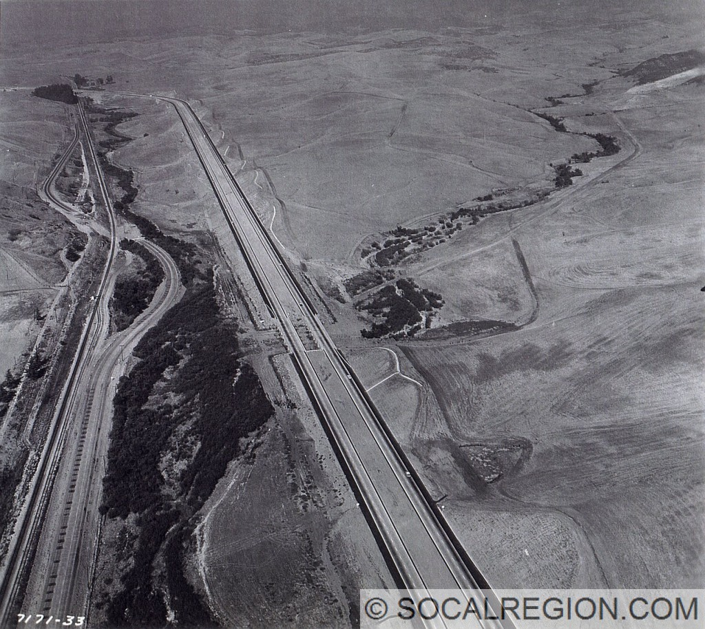 Aerial view of the 5 just south of Oso Pkwy about 1960. Roadway to the left is the former alignment of US 101, which still exists today.