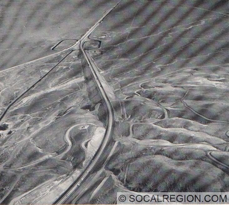 """1960 view of """"The Loop"""" curve sliced through by the new northbound lanes on I-5. Grapevine (1960) is at the point the sides of the freeway converge."""