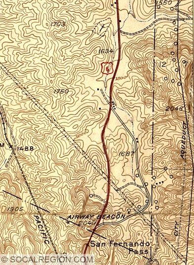 Topographical map showing the 1930 bypass to the left (red line) and original alignment to the right.